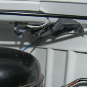 We put some duct tape around the screw terminal block and taped it to the ceiling. The heating cable runs through the water hole and we don't want water to run along the cable into the terminal block. Also notice the cable duct.