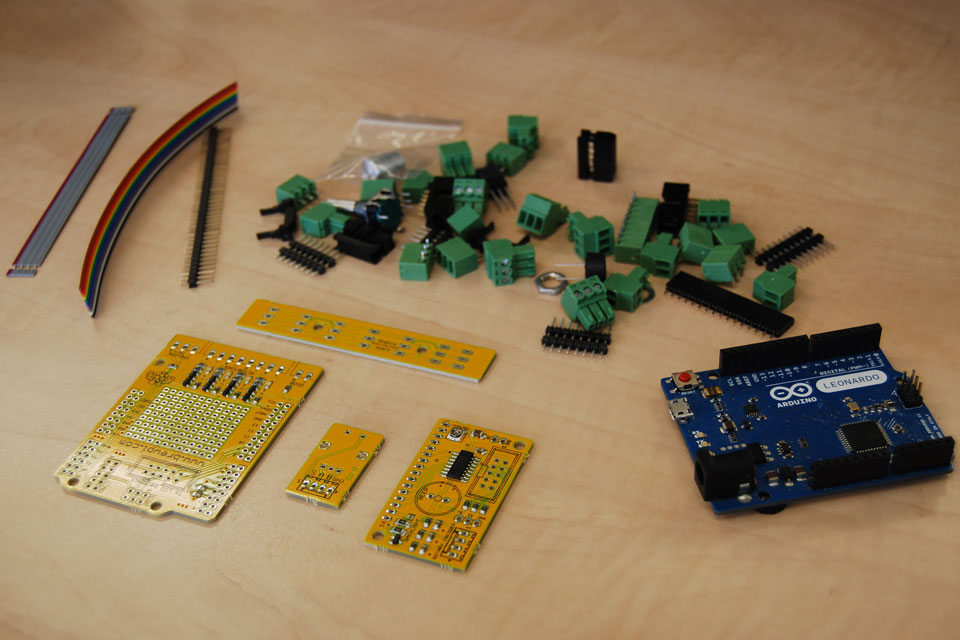 You now have 4 separate boards: the main shield, the LCD backpack, the rotary encoder breakout board and the OneWire distribution board. Time to start soldering!
