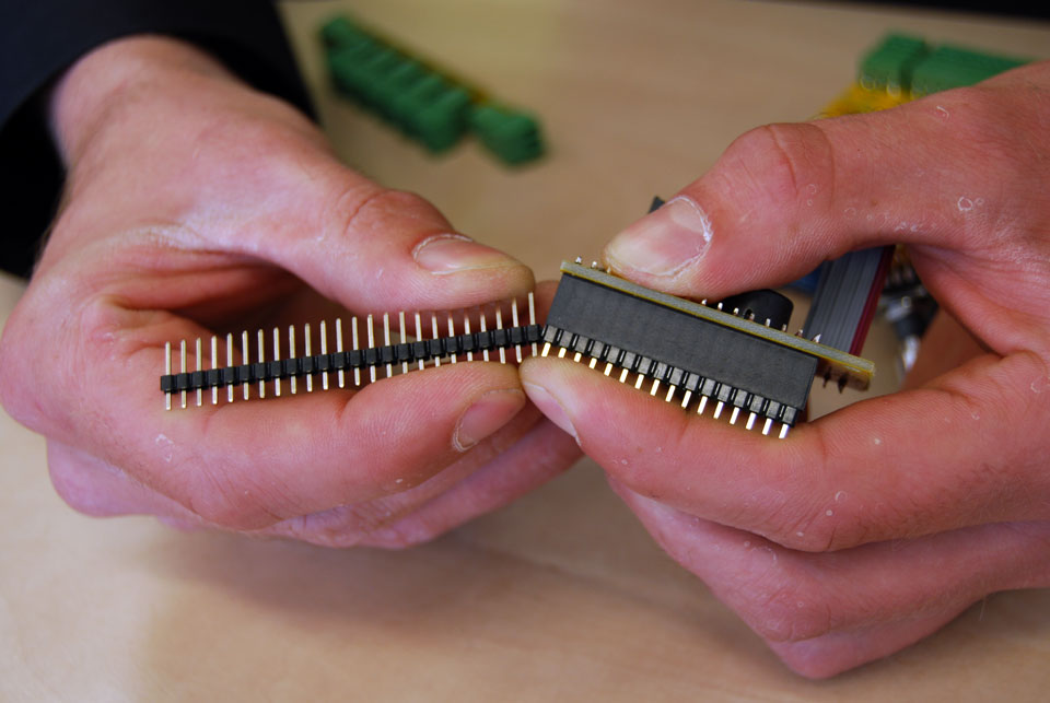 You got a 40pin header with the kit, so you will have to break off 16 pins. A reliable way of doing this is inserting the connector in the female header and applying force like in this picture, while keeping pressure on the last pin in the header.